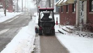 edmonton condominium sidewalk snow removal tractor